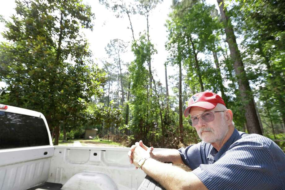 "Warren Oja, a Sam Houston National Forest District ranger, is looking at urban growth, including expansion of Interstate 45, with a worried eye. ""There are now six lanes to our doorstep,"" he says.