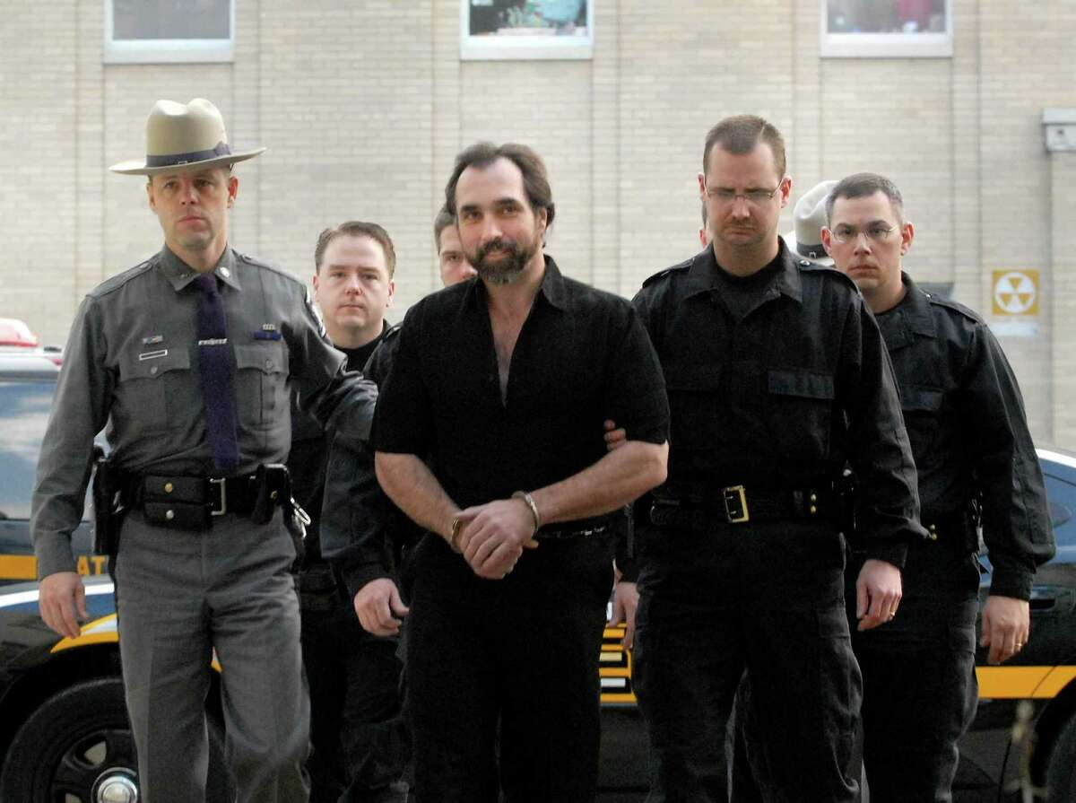 """Ralph """"Bucky"""" Phillips is led into Chemung County Court, Nov. 29, 2006, in Elmira, N.Y. (Michael P. Farrell/Times Union)"""