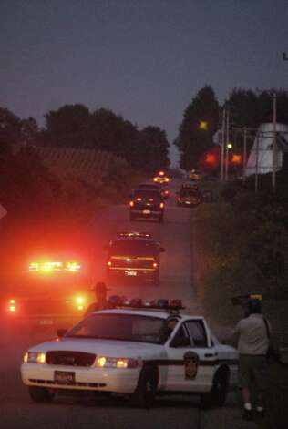"Troopers rush to the scene where  Ralph ""Bucky"" Phillips had revealed his location Friday evening Sept. 8 2006, outside of Akeley, Pa. (Will Waldron/Times Union) Photo: WW / ALBANY TIMES UNION"