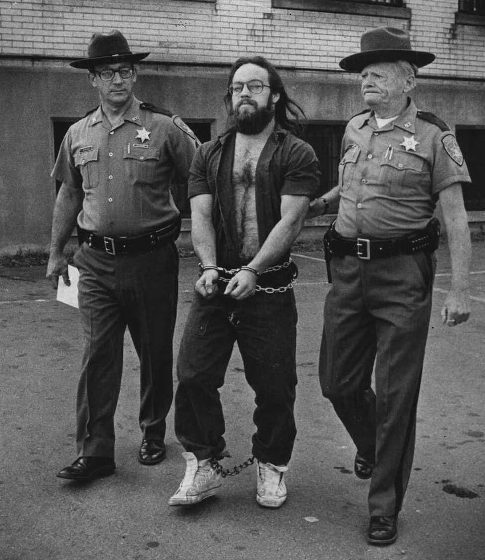 Police capture Gary Evans following his 1980 escape from the Rensselaer County Jail. (Times Union archive)