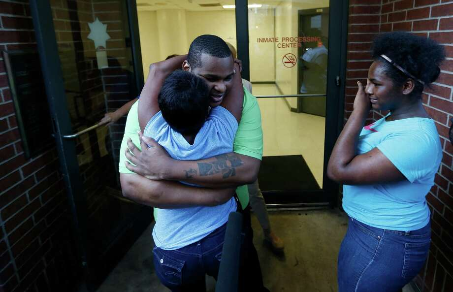 Alfred Brown greets his sister Connie Brown upon his release from the Harris County Jail on Monday. Photo: Karen Warren, Staff / © 2015 Houston Chronicle