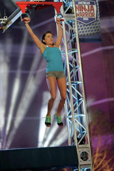 "Kacy Catanzaro competes in the Houston qualifiers of ""American Ninja Warrior,"" which aired on NBC on June 8, 2015. Photo: Bob Levey /NBC / 2015 NBCUniversal Media, LLC"