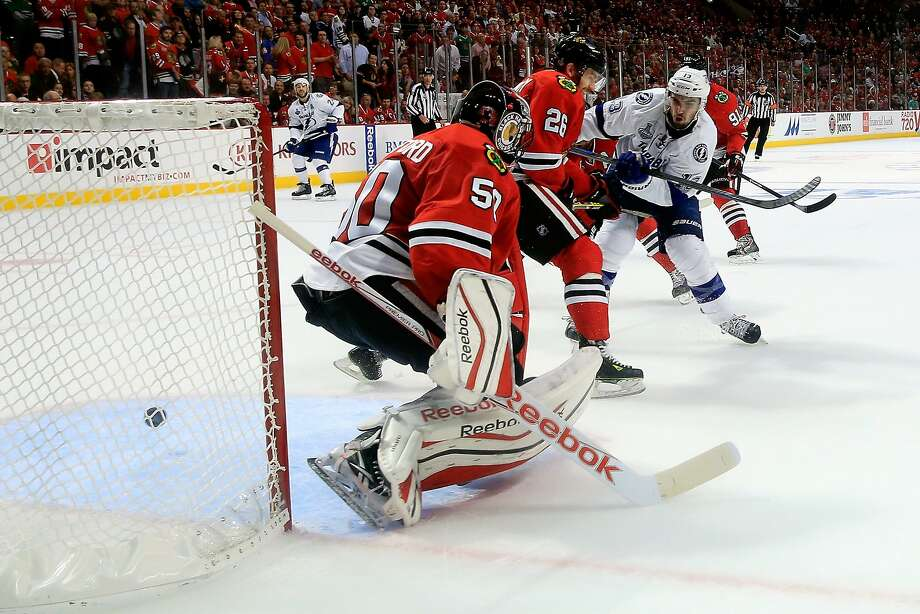 The Lightning's Cedric Paquette fires the puck past Blackhawks goalie Corey Crawford for the decisive goal in Game 3 of the Stanley Cup Finals in Chicago. Photo: Tasos Katopodis, Getty Images