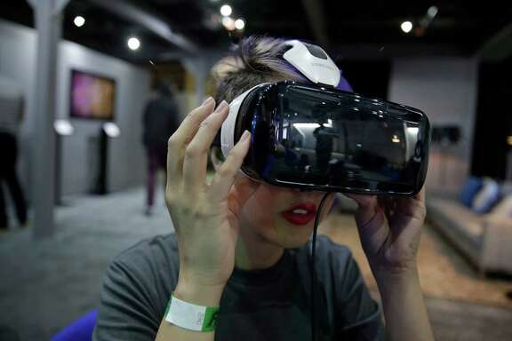 A demonstration shows the capabilities of the Oculus virtual reality headset this spring at the Facebook F8 Developers Conference in San Francisco. Major movie studios and others are adopting the technology.