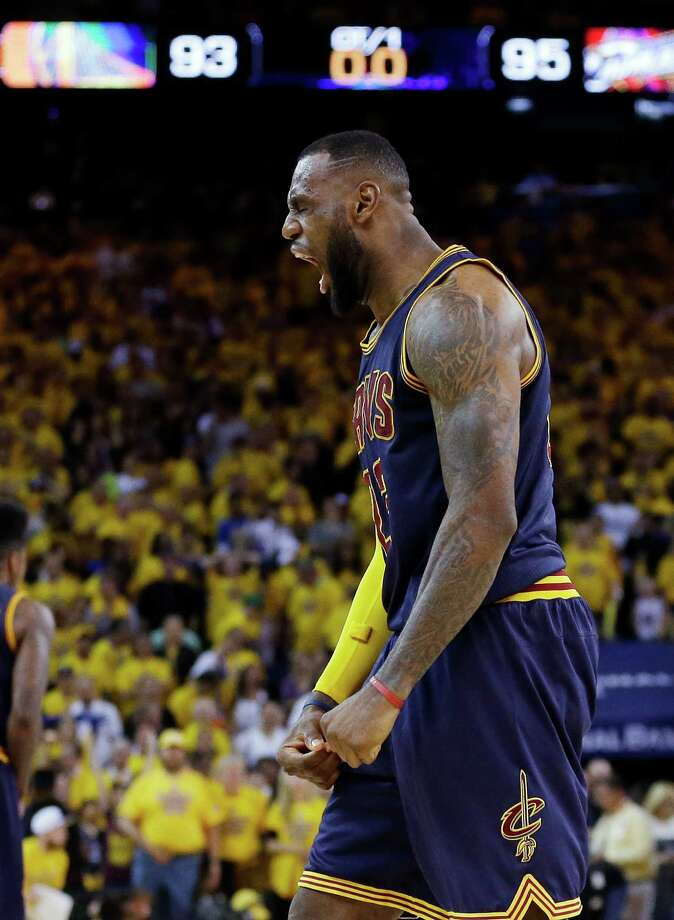 Cleveland Cavaliers forward LeBron James (23) celebrates after end of the overtime period of Game 2 of basketball's NBA Finals against the Golden State Warriors in Oakland, Calif., Sunday, June 7, 2015. The Cavaliers won 95-93 in overtime. (AP Photo/Ben Margot) ORG XMIT: OAS161 Photo: Ben Margot / AP