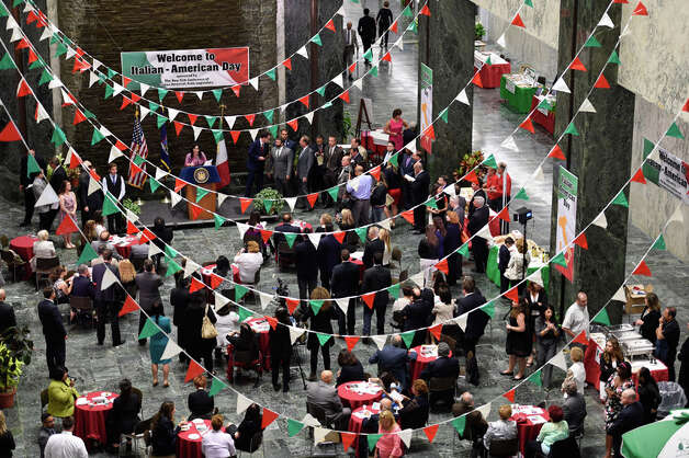 A festive atmosphere is complemented by beautifully colored flags at the Italian Day celebration Monday afternoon in the well at the Legislative Office Building June 8, 2015 in Albany, N.Y.   (Skip Dickstein/Times Union) Photo: SKIP DICKSTEIN, ALBANY TIMES UNION / 00032066A