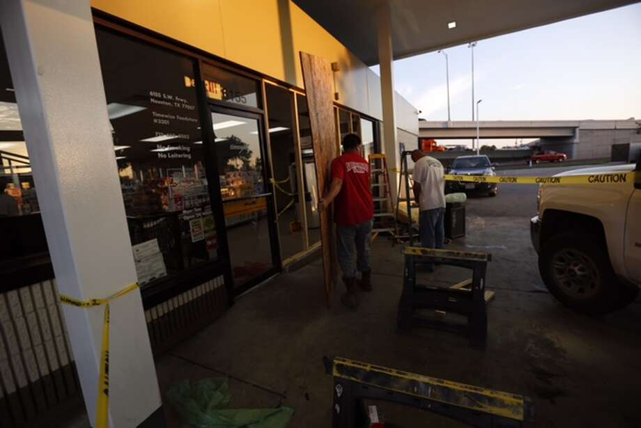 Multiple theft suspects robbed a southwest Houston gas station following a failed attempt at a smash and grab early June 9, 2015. Photo: Cody Duty / Houston Chronicle