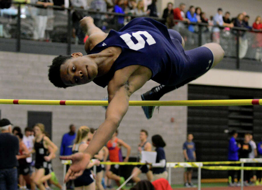 Staples' Anthony Bravo competes in the high jump, during FCIAC track championship action in New Haven, Conn. on Tuesday Feb. 5, 2015. Photo: Christian Abraham / Christian Abraham