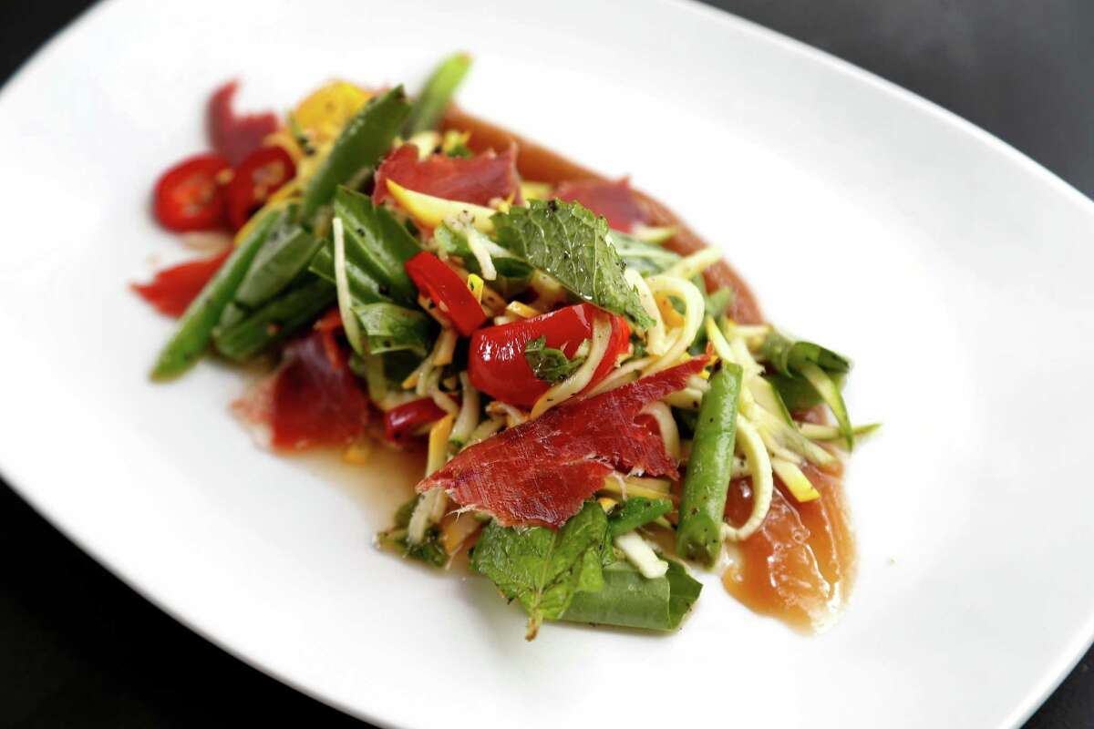 The Summer Squash, heirloom tomato, pole beans, pecans, chills, country ham, and tamarind at Revival Market at White Oak and Heights is is now offering dinner.