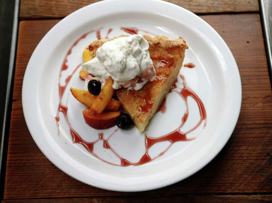 Revival Market's Buttermilk Pie features Luxardo gastrique, peaches and cream. Dinner is served Tuesday through Sunday. Photo: Karen Warren, Staff / © 2015 Houston Chronicle