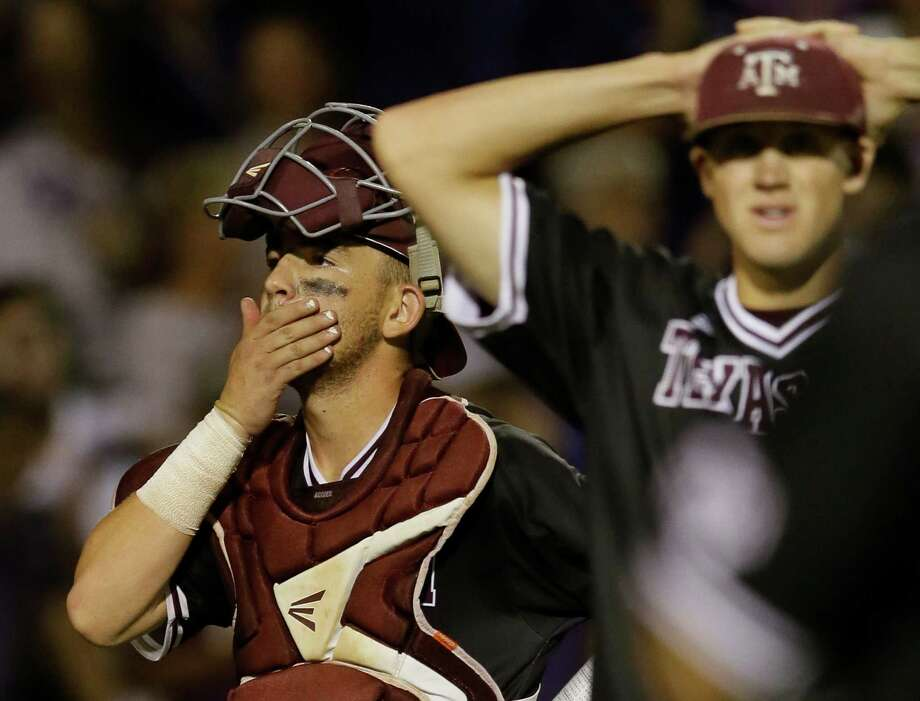 Texas A&M catcher Michael Barash, left, and pitcher Kyle Simonds react after losing to TCU in the 16th inning of a super regional of the NCAA college baseball tournament in Fort Worth on Monday, June 8, 2015. TCU won 5-4. Photo: Tim Sharp /Associated Press / FR62992 AP