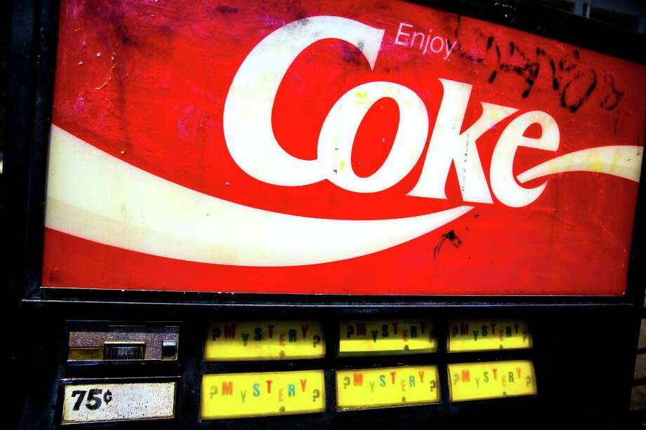 """Located on the corner of John Street and 10th Avenue East in Capitol Hill sits the """"Mystery Coke Machine,"""" as photographed Thursday, April 30, 2015, in Seattle, Washington. For 75 cents (and later $1), passerby may indulge in a variety of sodas, yet the questions of who first installed the outdoor machine, who stocks it and who collects the money all equally remain mysteries. Photo: JORDAN STEAD, SEATTLEPI.COM / SEATTLEPI.COM"""