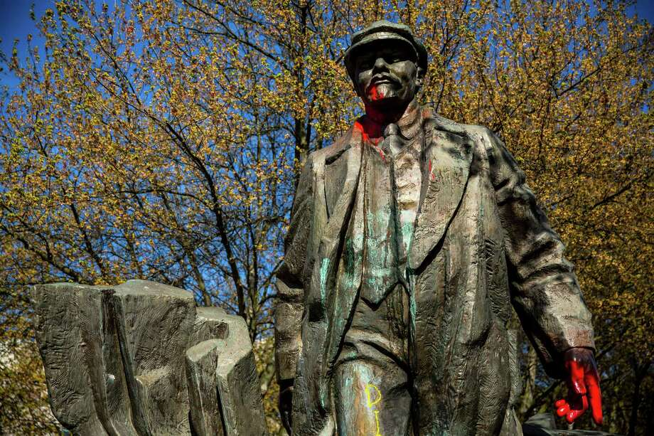 """Spattered in red """"blood"""" paint, Fremont's provocative bronze statue of Russian communist revolutionary Vladimir Lenin, photographed Sunday, April 19, 2015, in Seattle, Washington. The piece was salvaged from Czechoslovakia in 1993 by an Issaquah resident living in the Central European country. Photo: JORDAN STEAD, SEATTLEPI.COM / SEATTLEPI.COM"""