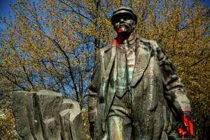 """Spattered in red """"blood"""" paint, Fremont's provocative bronze statue of Russian communist revolutionary Vladimir Lenin, photographed Sunday, April 19, 2015, in Seattle, Washington. The piece was salvaged from Czechoslovakia in 1993 by an Issaquah resident living in the Central European country."""