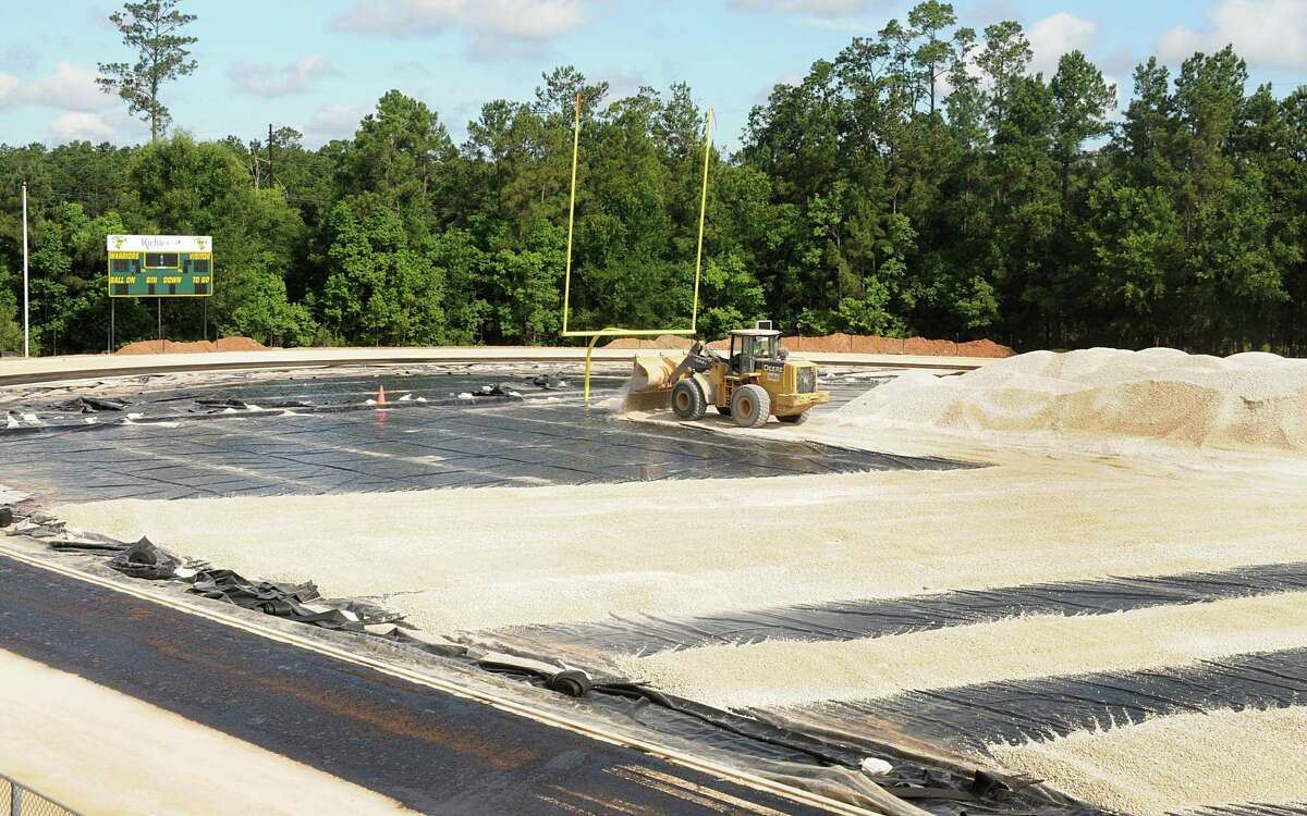The Woodlands Christian Academy $2.5 million dollar construction of a six lane track and adding artificial turf for the football field is underway. The school is also adding seating to the athletic field. Photograph by David Hopper.