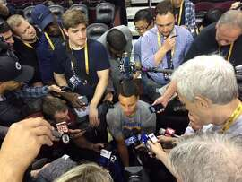 Golden State Warriors star Steph Curry is surrounded by media at the Tuesday morning shootaround in Cleveland before Game 3 of the NBA Finals.