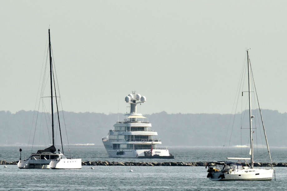The yacht Fountainhead, center, can be seen anchored off shore from Stamford Harbor in the Long Island Sound on Monday, June 8, 2015. According to forbes.com, billionaire Dallas Mavericks owner Mark Cuban, owns a yacht with the same name that is 288 feet long. Photo: Jason Rearick / Staff Photographer / Stamford Advocate