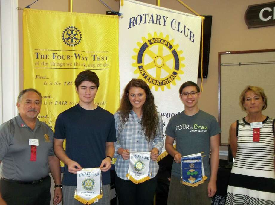 Students Julian Falco, second from left, Kristen Olansen and Adrian Falco, were selected to serve as Rotary Club ambassadors in France for a summer youth exchange  program. Also pictured are Rotary Club of Friendswood President Bill Provenzano, left, and Chris Turner, the club's Youth Exchange Program officer. Photo: Rotary Club Of Friendswood