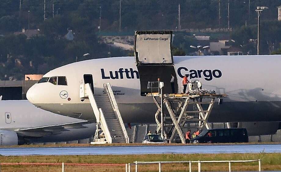 People load remains of the Germanwings flight crash victims onto a cargo plane in Marignane, France. Photo: Anne-Christine Poujoulat, AFP / Getty Images