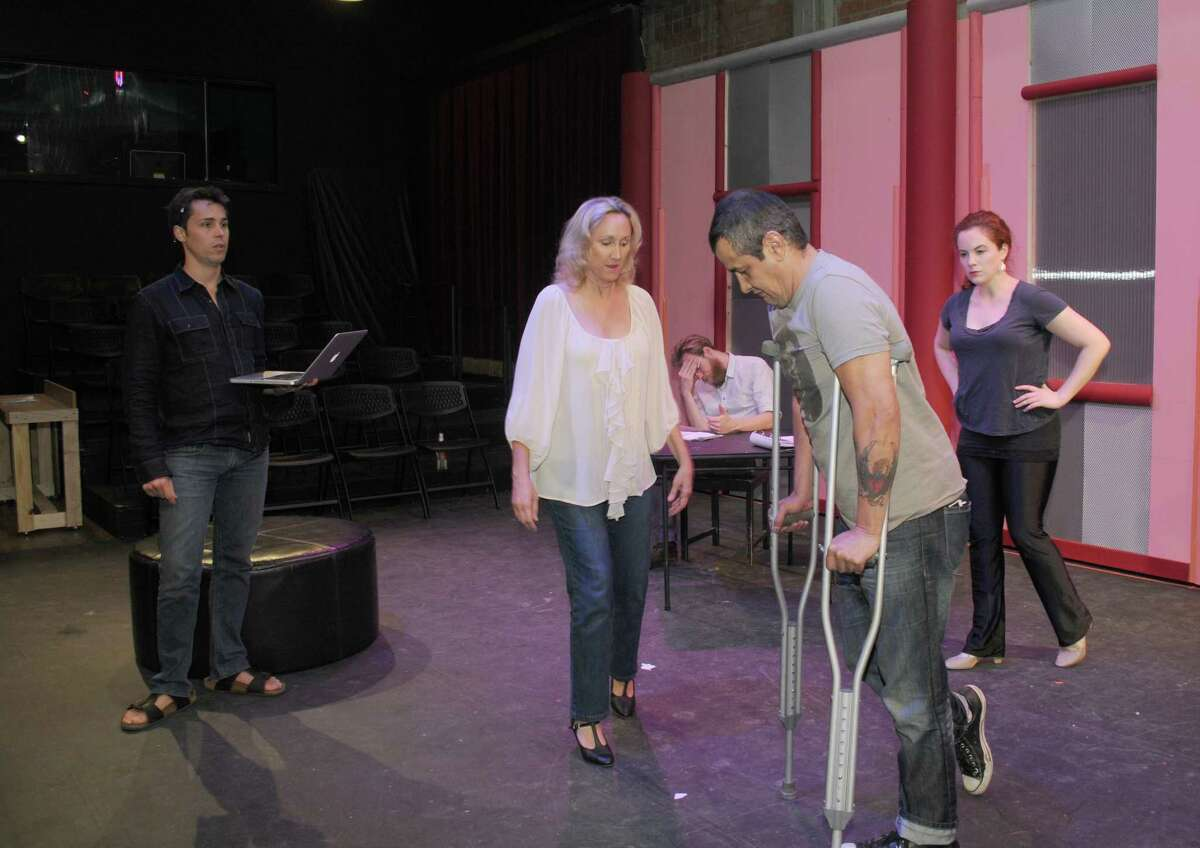 """Luis Galindo of Alvin, center, relishes portraying an actor in Stark Naked Theatre Company's production of """"Stage Kiss."""" Also performing in the play are Kim Tobin-Lehl, Philip Hays, Luis Galindo of Alvin and Molly Searcy"""