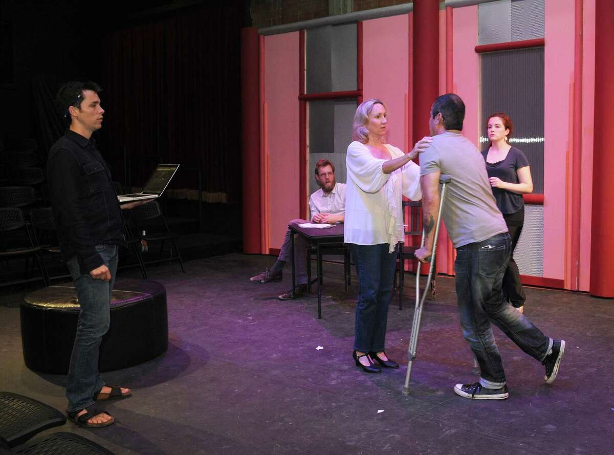 """Brandon Weinbrenner, left, director for Stark Naked Theater Company's """"Stage Kiss,"""" guides Philip Hays, Kim Tobin-Lehl, Luis Galindo and Molly Searcy in a rehearsal."""