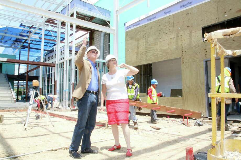 Chuck Still, executive director of the planned Midtown Arts and Theatre Center Houston, and Rebecca Udden, founding artistic director of Main Street Theater, tour the construction site for MATCH's center. A capital campaign has reached more than 90 percent of its goal. Photo: Pin Lim, Freelance / Copyright Forest Photography, 2015.
