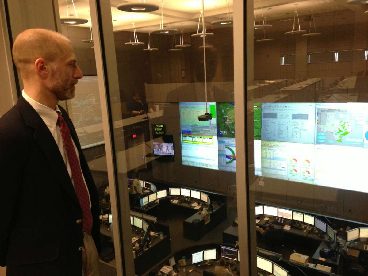 Warren Lasher, ERCOT's director of system planning looks out over the control room.