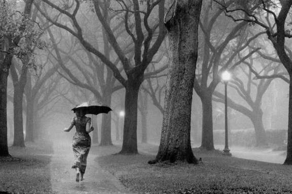 04/1979 - woman caught in afternoon thunderstorm near Rice University.