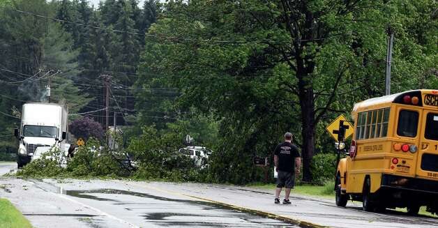 A large tree branch blocks Main Street Tuesday afternoon, June 9, 2015,  after a strong storm moved through Jonesville, N.Y.      (Skip Dickstein/Times Union) Photo: SKIP DICKSTEIN