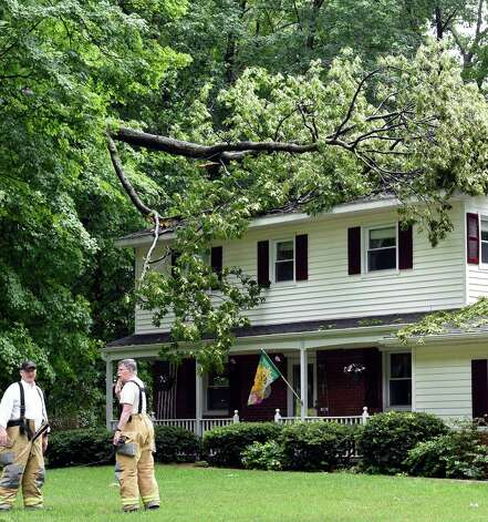 A large tree branch sits on the roof of 26 Heritage Lane Tuesday afternoon, June 9, 2015, after a strong storm moved through Jonesville, N.Y.      (Skip Dickstein/Times Union) Photo: SKIP DICKSTEIN