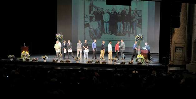 Students in the Automotive Technician program come up on stage to receive their certificates as students in the Capital Region BOCES program took part in the Capital Region Career and Tech Awards and Recognition Ceremony on Tuesday, June 9, 2015, at Proctors Theater in Schenectady, N.Y.   (Paul Buckowski / Times Union) Photo: PAUL BUCKOWSKI / 00032203A