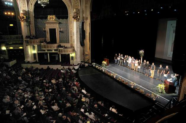 Students in the Welding and Metal Fabrication program stand on stage as family and friends cheer them as students in the Capital Region BOCES program took part in the Capital Region Career and Tech Awards and Recognition Ceremony on Tuesday, June 9, 2015, at Proctors Theater in Schenectady, N.Y.   (Paul Buckowski / Times Union) Photo: PAUL BUCKOWSKI / 00032203A