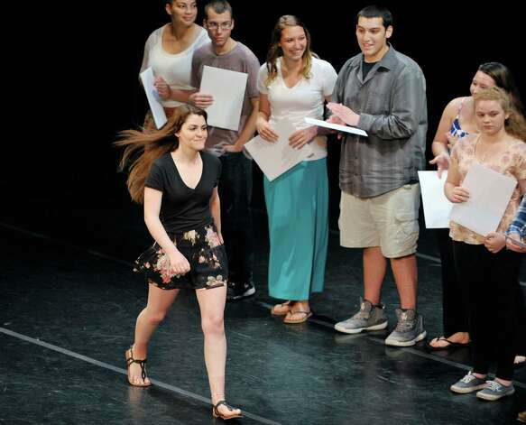 Kristina Zanella a student in the Criminal Justice I program walks up to receive her certificate as students in the Capital Region BOCES program took part in the Capital Region Career and Tech Awards and Recognition Ceremony on Tuesday, June 9, 2015, at Proctors Theater in Schenectady, N.Y.   (Paul Buckowski / Times Union) Photo: PAUL BUCKOWSKI / 00032203A