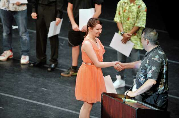 Sarah Murray, a student in the Computer/Network Tech/IT program receives her certificate as students in the Capital Region BOCES program took part in the Capital Region Career and Tech Awards and Recognition Ceremony on Tuesday, June 9, 2015, at Proctors Theater in Schenectady, N.Y.   (Paul Buckowski / Times Union) Photo: PAUL BUCKOWSKI / 00032203A