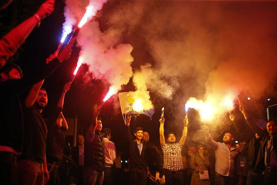 Supporters of Turkey's ruling Justice and Development Party celebrate after the election results came out in Istanbul, Turkey, late Sunday, June 7, 2015. With 99.9 percent of the vote counted, Erdogan's AKP had the support of around 41 percent of voters, state-run TRT television said. Photo: Emrah Gurel, Associated Press