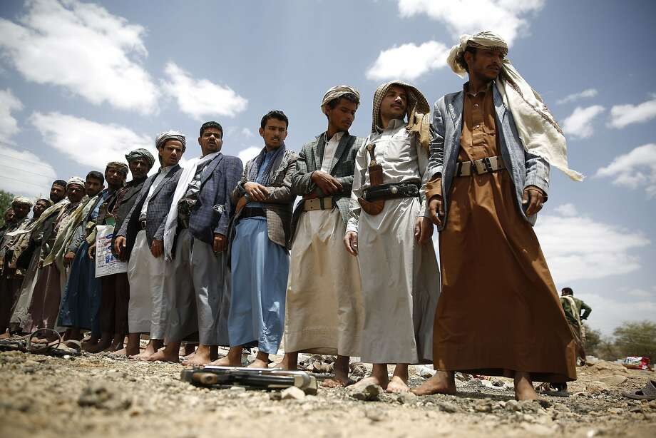 Houthi rebels attend a funeral for fellow fighters killed in a Saudi air strike.They are also fighting the al Qaeda affiliate in Yemen. Photo: Hani Mohammed, Associated Press