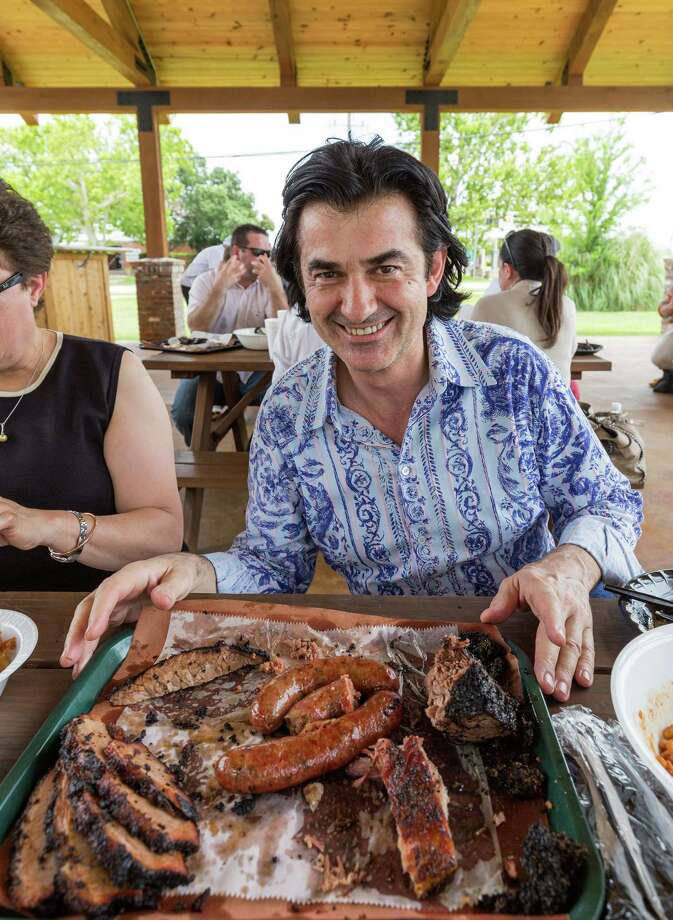 About 70 French, Canadian and U.S. chefs and their families enjoy barbecue at Killen's Barbecue, 3613 E. Broadways Street, Pearland, Texas. For many, it will be their first taste of authentic Central Texas-style barbecue. ID: Houston's own French Cowboy, chef Philippe Schmit. Tuesday  June 9, 2015 Photo: Craig Hartley, For The Chronicle / Copyright: Craig H. Hartley