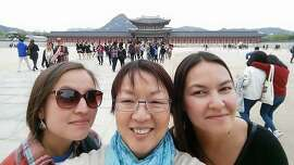 Keren Colston of Novato and her daughters at Gyeongbokgung Palace in Seoul, South Korea.