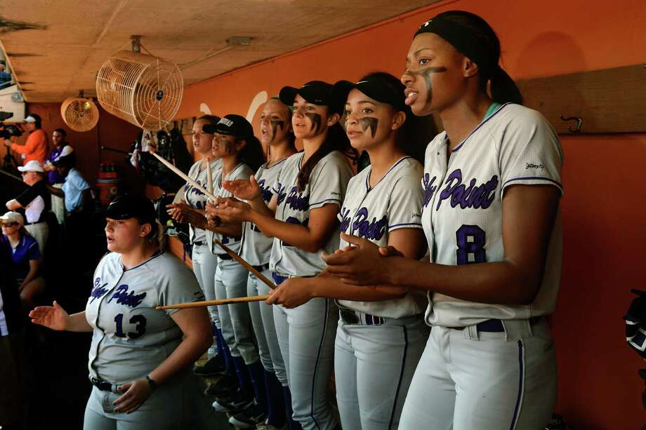 Ridge Point Panthers Gabby Garrison, from right, Allison Washington, Lindsey Longuet, Bri Nunn, Helena Febre, Lauren Stickler and Kendal Stafford (13), cheer for their teammates while they bat in the top of the 1st inning against the Aledo Ladycats in their Class 5A UIL State Softball Championship semi-final matchup at McCombs Field in Austin on Friday, June 5, 2015. (Photo by Jerry Baker/Freelance) Photo: Jerry Baker, Freelance