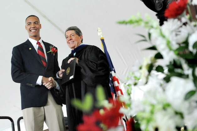 Graduate Marcus Alexander Pryor, left, receives his diploma from Head of School Douglas North during commencement exercises on Tuesday, June 9, 2015, at The Albany Academy in Albany, N.Y. The graduate's father, Marcus Pryor, Chairman of the Albany Tulip Festival, is also an alum of the school. (Cindy Schultz / Times Union) Photo: Cindy Schultz / 00032210A