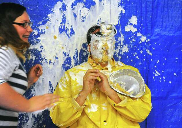 Scotia-Glenville Middle School Principal Robert Cosmer gets a pie in the face from eighth grade student Aviana Hernadez as part of a fundraiser for the Muscular Dystrophy Association on Tuesday June 9, 2015 in Scotia , N.Y.  (Michael P. Farrell/Times Union) Photo: Michael P. Farrell / 00032206A
