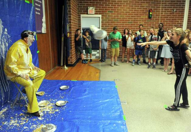 Scotia-Glenville Middle School Principal Robert Cosmer gets a pie in the face from seventh grade student Gabby Tallman as part of a fundraiser for the Muscular Dystrophy Association on Tuesday June 9, 2015 in Scotia , N.Y.  (Michael P. Farrell/Times Union) Photo: Michael P. Farrell / 00032206A