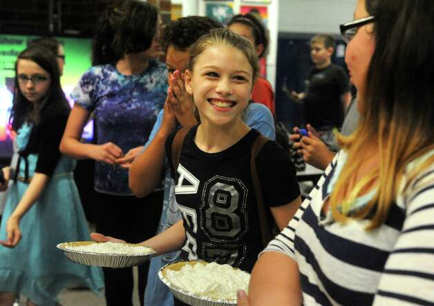 Seventh grade student Gabby Tallman holds pies to be thrown at Scotia-Glenville Middle School Principal Robert as part of a fundraiser for the Muscular Dystrophy Association on Tuesday June 9, 2015 in Scotia , N.Y.  (Michael P. Farrell/Times Union) Photo: Michael P. Farrell / 00032206A