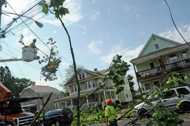 Crews from Asplundh Tree Experts clear downed branches from untility lines following a passing storm on Tuesday June 9, 2015 in Scotia , N.Y.  (Michael P. Farrell/Times Union) Photo: Michael P. Farrell