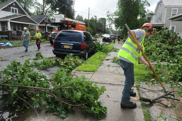 Crews from Asplundh Tree Experts clear downed branches following a passing storm on Tuesday June 9, 2015 in Scotia , N.Y.  (Michael P. Farrell/Times Union) Photo: Michael P. Farrell