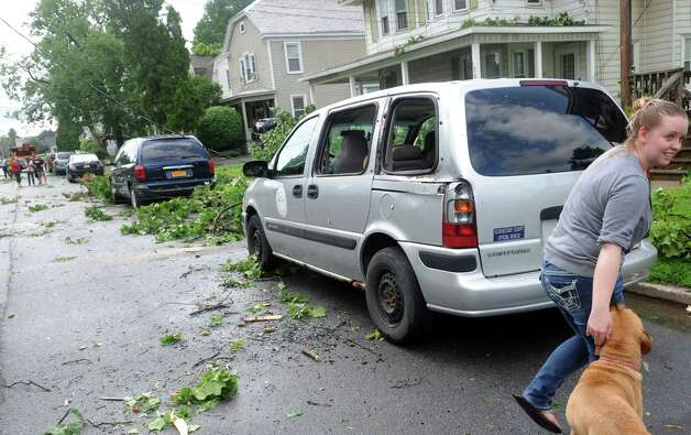 A vehicle sits damaged on Sixth Street following a passing storm on Tuesday June 9, 2015 in Scotia , N.Y.  (Michael P. Farrell/Times Union) Photo: Michael P. Farrell