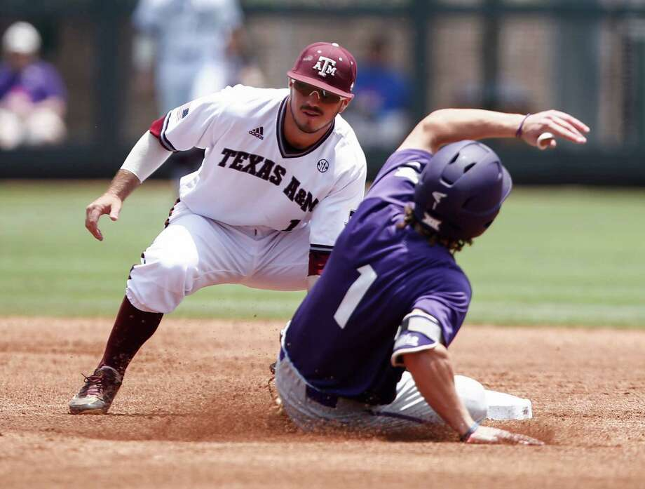 TCU's Cody Jones (1) is tagged out while attempting to steal second base by Texas A&M shortstop Blake Allemand, left, during the first inning of a super regional of the NCAA college baseball tournament in Fort Worth, Texas, Sunday, June 7, 2015. Photo: Jim Cowsert /Associated Press / FR170531 AP