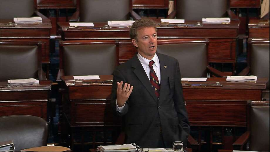 Sen. Rand Paul, a presidential candidate, delivers a long speech in the Senate opposing renewal of the Patriot Act. Paul claimed he was filibustering, but under the Senate rules, he wasn;t. Filibuster or not, a reader praises his efforts. Photo: /Associated Press / Senate TV