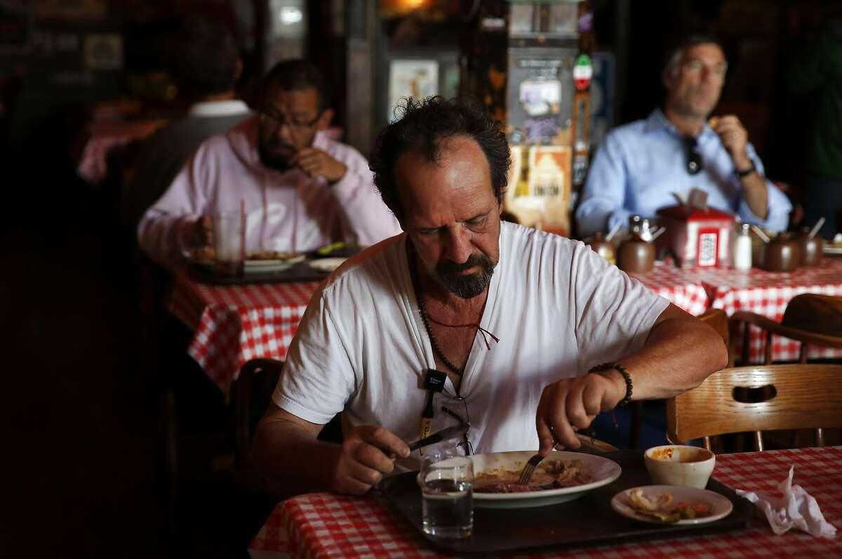 Michael Labunsky finishes up his lunch at Tommy's Joynt June 9, 2015 in San Francisco, Calif.