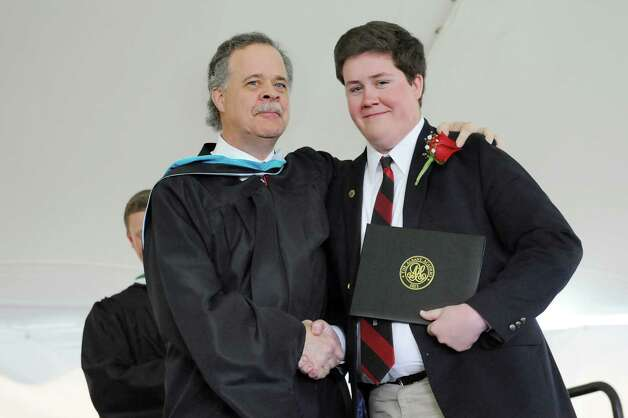 Graduate Charles Bender, right, receives his diploma from his father, Christian Bender, who is a school trustee and alum, during commencement exercises on Tuesday, June 9, 2015, at The Albany Academy in Albany, N.Y. (Cindy Schultz / Times Union) Photo: Cindy Schultz / 00032210A